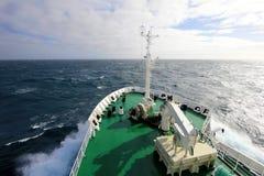 Ship`s Bow diving into a big splashing wave, Antarctica Stock Photos