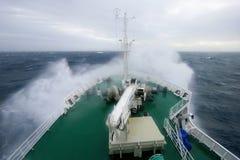 Ship`s Bow diving into a big splashing wave, Antarctica Stock Photography
