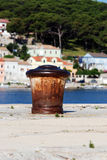 Ship's buoy in Mali Losinj pier,Croatia. Old,rusty ship's buoy in Mali Losinj harbour in a sunny summer day with blue sky Royalty Free Stock Photos