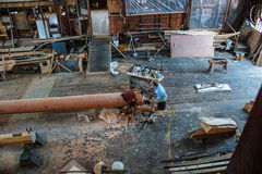 Ship's carpenter works on a new mast Stock Photos