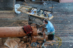 Ship's carpenter works on a new mast Royalty Free Stock Images