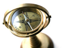 Ship's compass. A brass ornamental ship's compass. High key Stock Photography