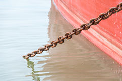 Ship`s hull painted with load chain line ,Red Ship Detail With big chain Stock Photo