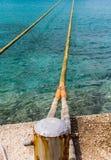 Yellow Ropes Across Aqua Water Royalty Free Stock Photo