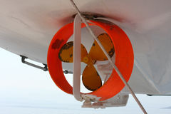 Ship's propeller. On the lifeboat on the ferry Royalty Free Stock Photo