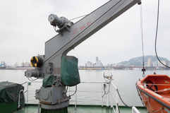 Ship`s rescue boat crane. Crane that lowers rescue boat to the sea Stock Photo