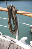 Ship's Riiging and Cordage Detail. Close up of a wooden cleat used to tie-off or belay rigging cordage on a sailing ship Stock Photo