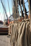 Ship's running rigging coiled and ready for sea. A sailing vessel's sheets and other running rigging stand coiled and ready to use Royalty Free Stock Image
