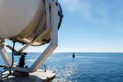 Ship`s searchlight against view to the small ship in fine clear weather stock images