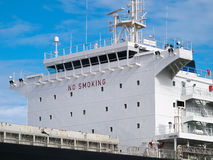 Ship's superstructure. Cargo ship anchored in port, side view of ship's superstructure Stock Photos