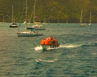 A ship's tender battling the chop in admiralty bay, bequia Stock Image