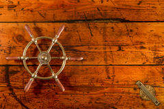 Ship's Wheel on Hatch Cover Table Stock Images