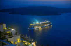 Ship sailing away from Santorini at night Royalty Free Stock Image