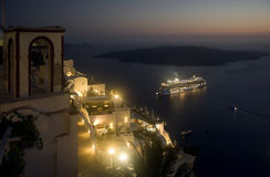 Ship sailing away from Santorini at night Stock Photography