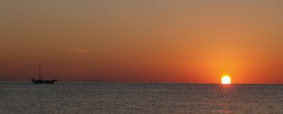 Ship sailing at dusk Stock Image
