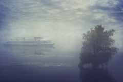 Ship sailing in the fog. River spill. Stock Photo