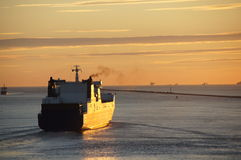 Ship sailing from Hoek van Holland at sunset Stock Photo