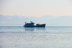 The ship, sailing on Lake Baikal Sayan Mountains in the background. Stock Image