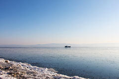 The ship, sailing on Lake Baikal Sayan Mountains in the background. Royalty Free Stock Image