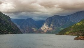 Ship sailing on the Norwegian fjords royalty free stock photography