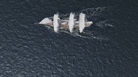 Ship sailing in rough seas aerial top view stock footage