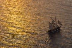 Ship sailing at sunset. A sailing ship in the mediterranean sea at sunset Stock Photos