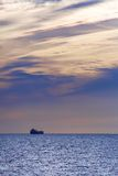 Ship sailing on sunset Royalty Free Stock Photography