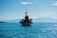 Ship is sailing to small Sarti harbor, Sithonia Stock Photos