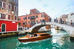 Ship sailing under bridge in Venice Stock Photos