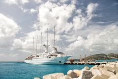 Ship or sailing yacht in Philipsburg, St Maarten. Philipsburg, St Maarten - February 13, 2016: Ship or sailing yacht in St Maarten at pier on sea or ocean beach Stock Photography
