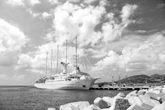 Ship or sailing yacht in Philipsburg, St Maarten. Philipsburg, St Maarten - February 13, 2016: Ship or sailing yacht in St Maarten at pier on sea or ocean beach Stock Images