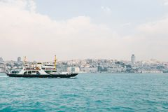 The ship sails along the blue water of the Bosphorus against the backdrop of a beautiful view of the European part of royalty free stock image