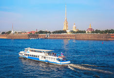 The ship sails along the Neva River near the Peter and Paul Fortress Stock Photo