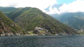 Ship sails along peninsula of Athos Royalty Free Stock Photography
