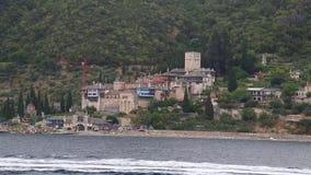 Ship sails along peninsula of Athos Stock Photography