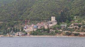 Ship sails along peninsula of Athos Stock Photos