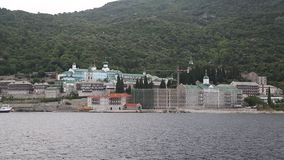 Ship sails along peninsula of Athos Stock Images
