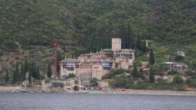 Ship sails along peninsula of Athos Stock Image