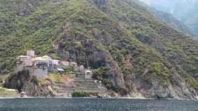 Ship sails along peninsula of Athos, in Greece Stock Images
