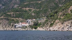 Ship sails along peninsula of Athos, in Greece Royalty Free Stock Photography