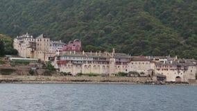 Ship sails along peninsula of Athos, Greece Royalty Free Stock Photography