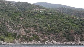 Ship sails along peninsula of Athos in Greece Stock Photo