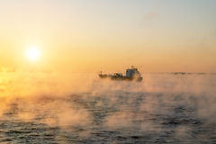 The ship sails at dawn in the fog of the cold winter sea.Estoni Royalty Free Stock Photos