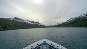 The ship sails into the fjord. Fjords in southern Iceland stock video