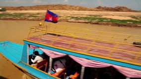 Ship sails on the river to the Tonle Sap lake in Siem Reap province, Cambodia stock video footage