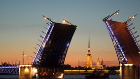 The ship sails under the diluted Palace Bridge. Night. St. Petersburg stock video