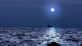 Ship sails under the moon in magical night on Koh