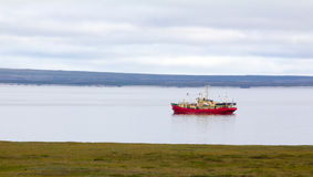 Ship sails in Yugorsky Strait to Barents sea Royalty Free Stock Photo