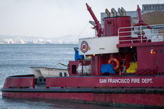 Ship in San Francisco. View of San Francisco and fire department ship in the Oakland Bay stock photography