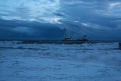 Ship in the sea. Ship during storm in the sea Royalty Free Stock Images